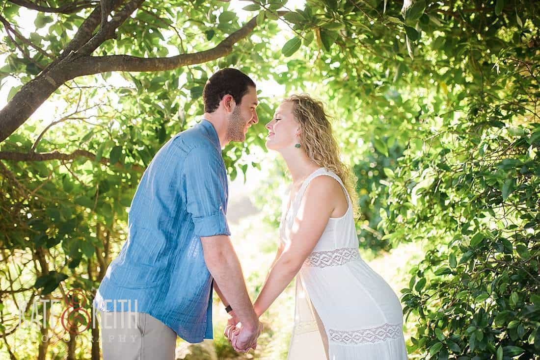 Kailua Engagement Photos rocks forest backlight hawaii trees