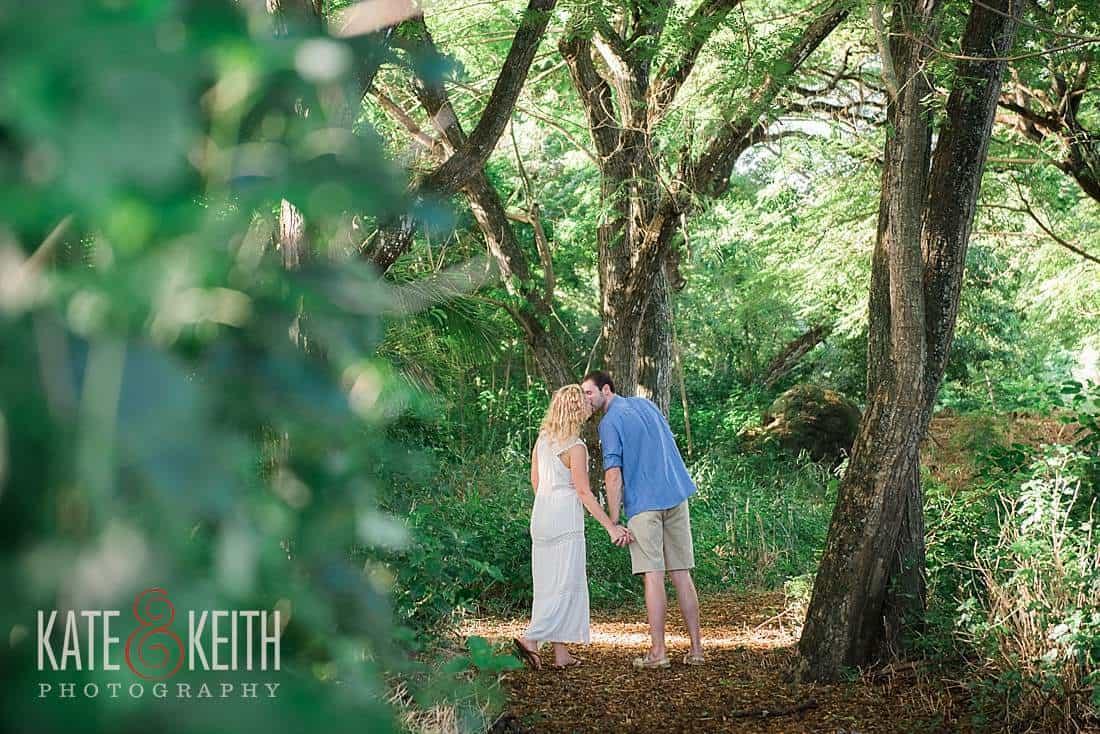 Kailua Engagement groom walks bride down path