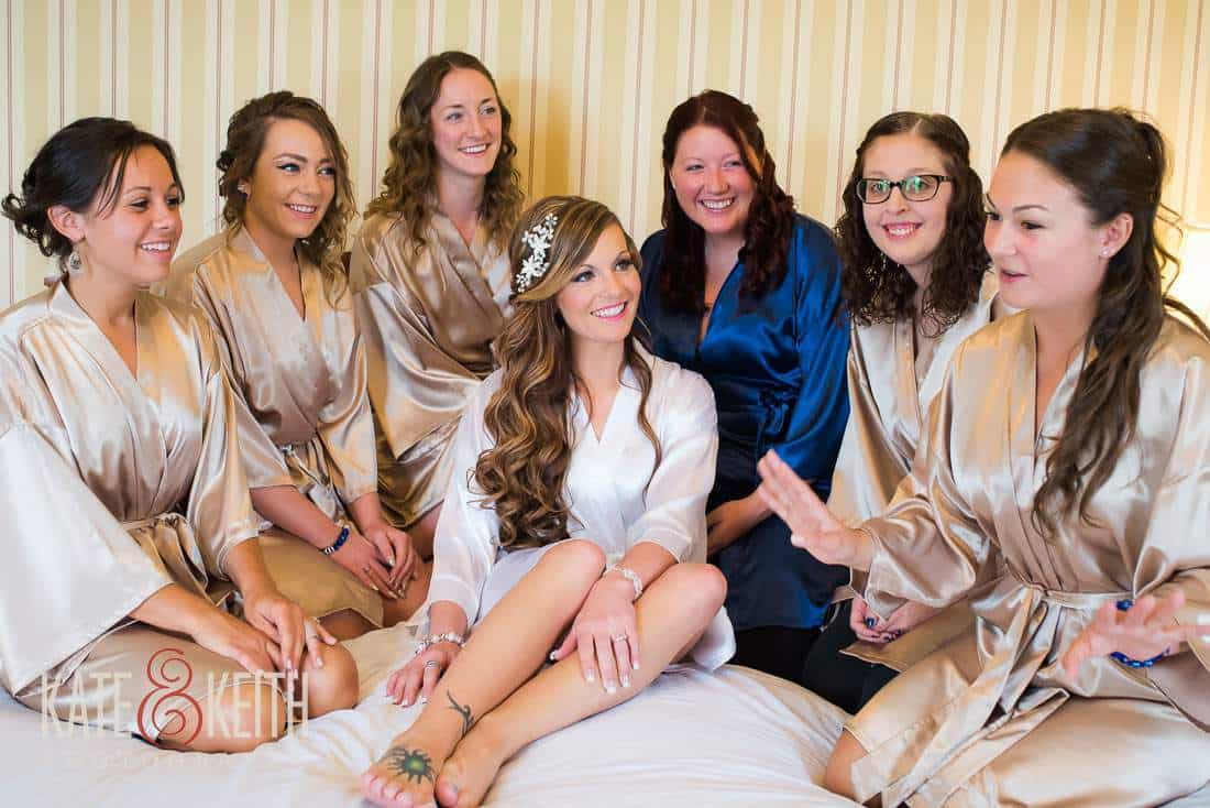 Bridesmaids and bride on bed