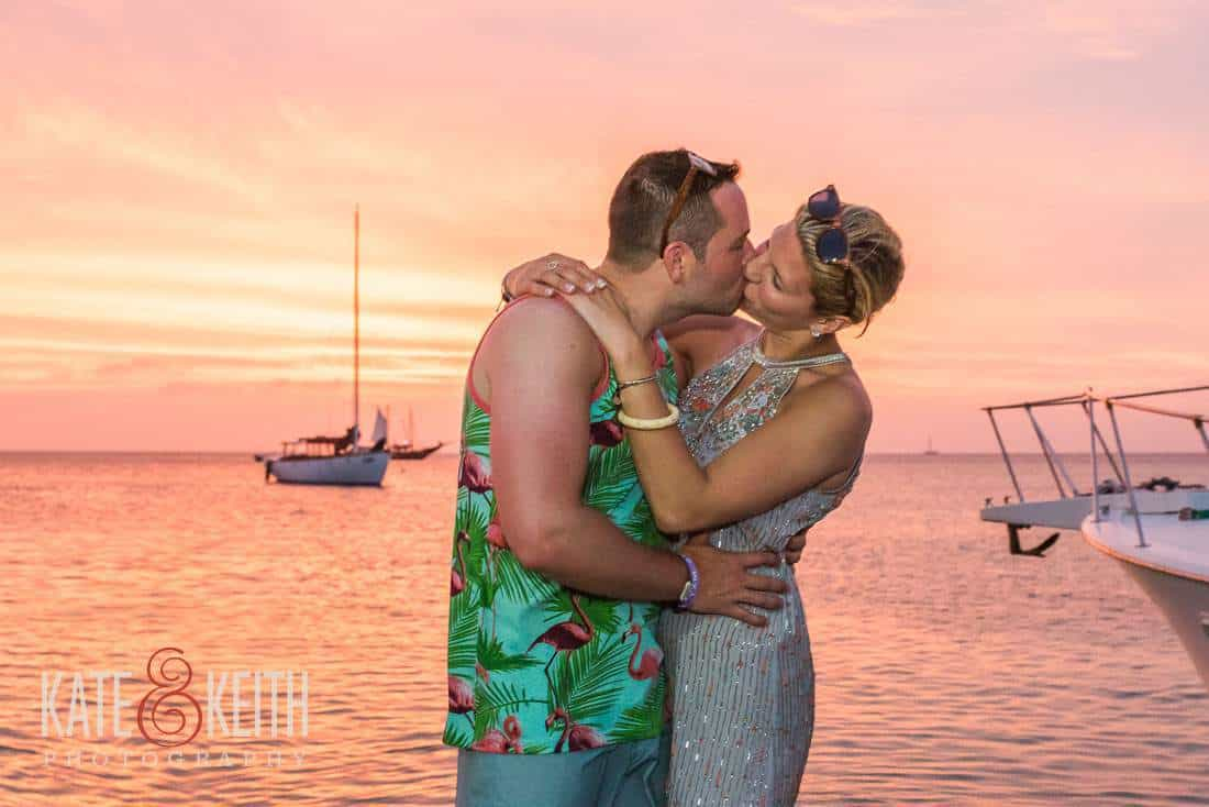 Caribbean sunset kissing couple