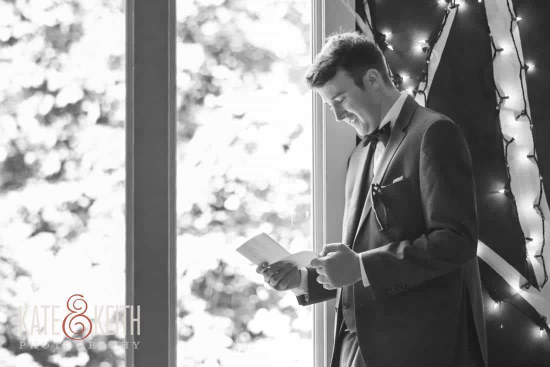 Maine Rustic Dapper Groom reading letter