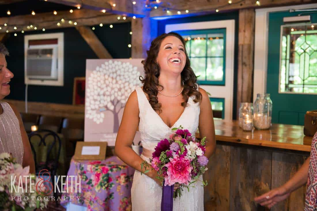 Laughing bride with flowers