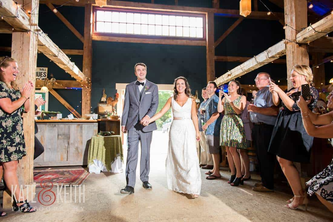 Country Bride and groom in barn