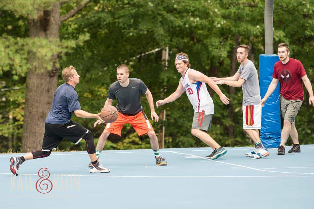 groom playing Basketball Maine wedding