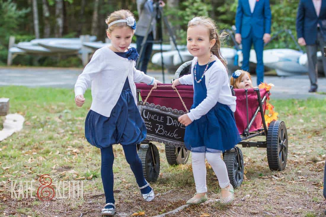 Ring bearer and flower girl in wagon