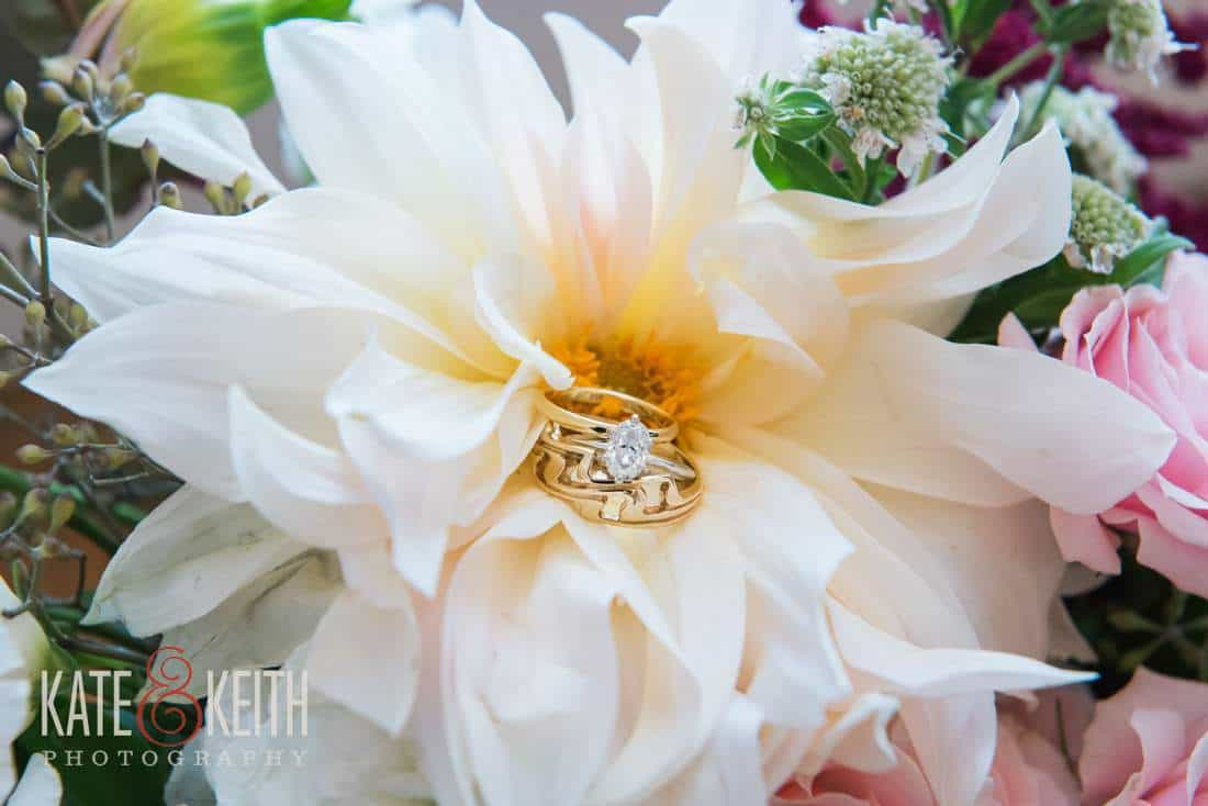 Gold wedding rings in flower