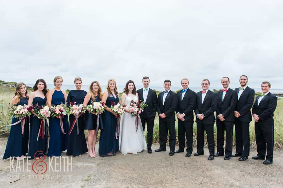 Formal wedding party on beach in Maine