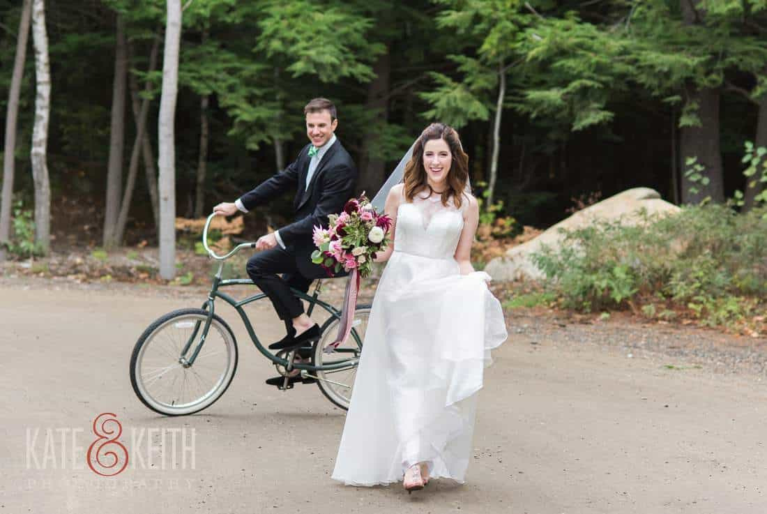 Bride and groom on bicycle on dirt road