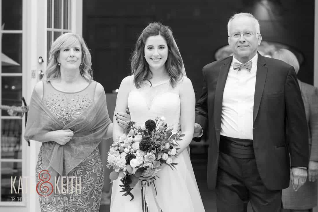 Black and white bride with mom and dad