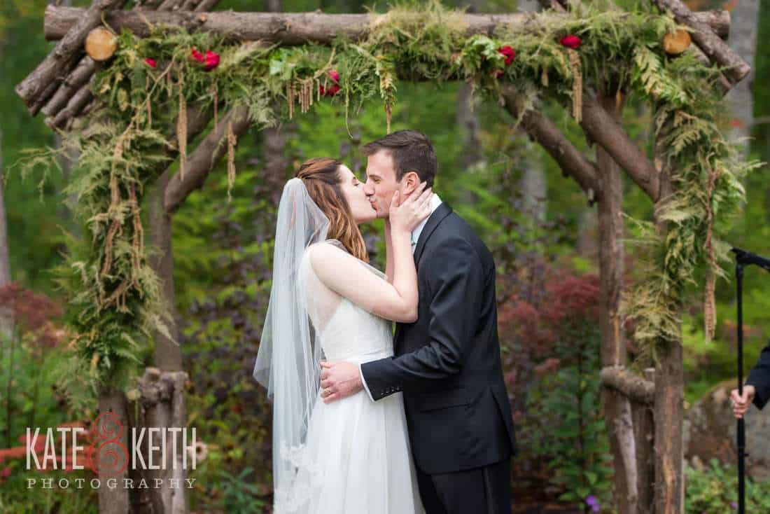 First kiss Hidden Pond outdoor wedding ceremony