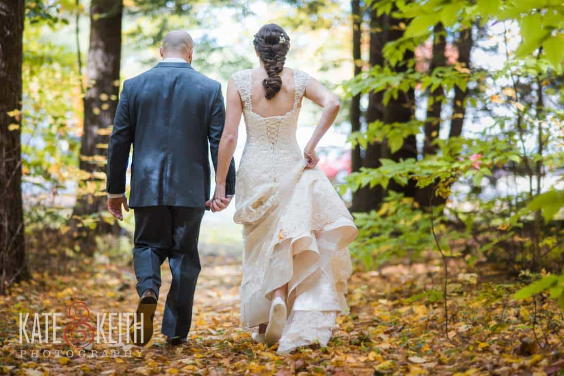 Bride, Groom walking in the woods during the fall