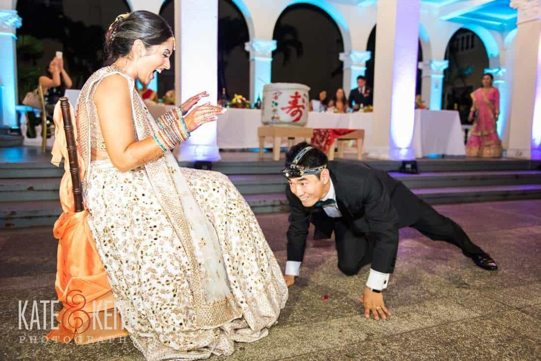 fun groom going for the garter belt