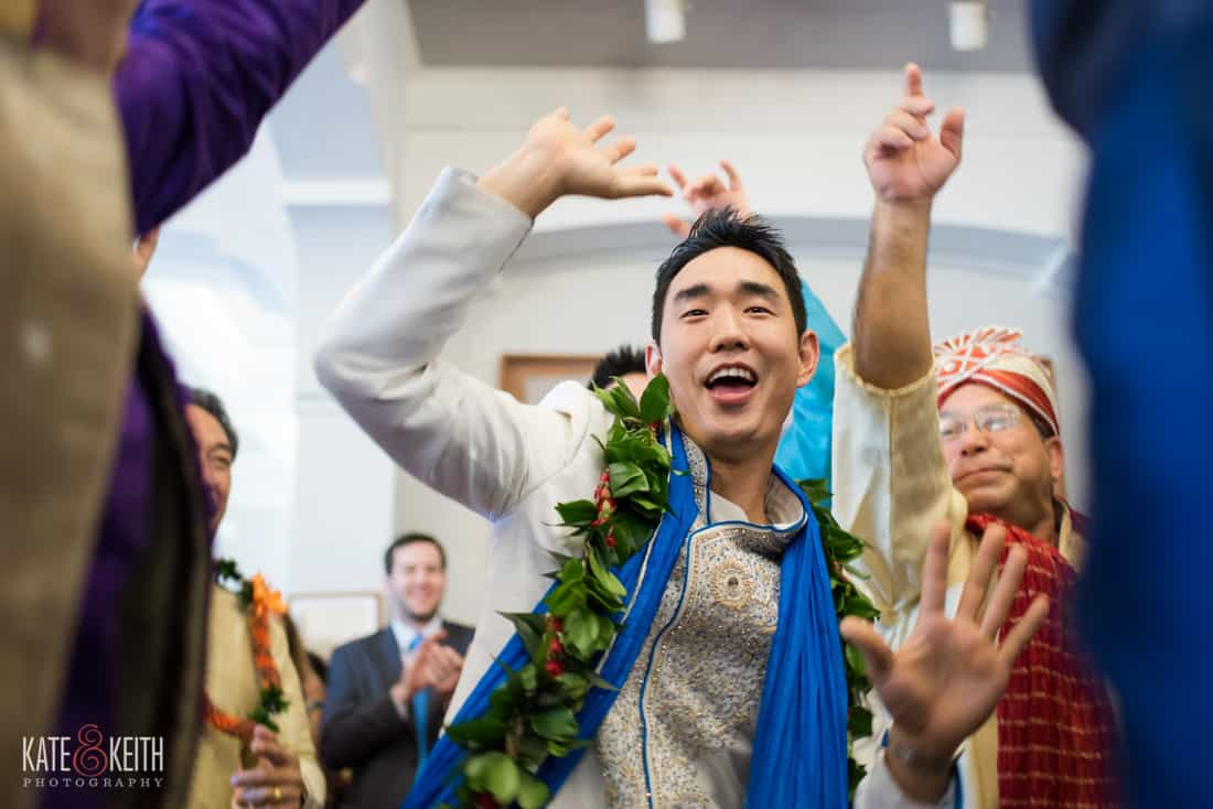 Groom celebrating wedding entrance