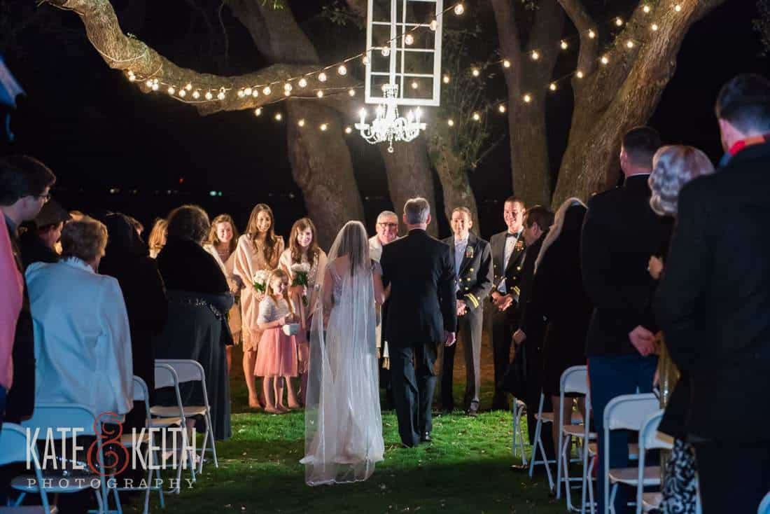father delivers bride outdoors at night