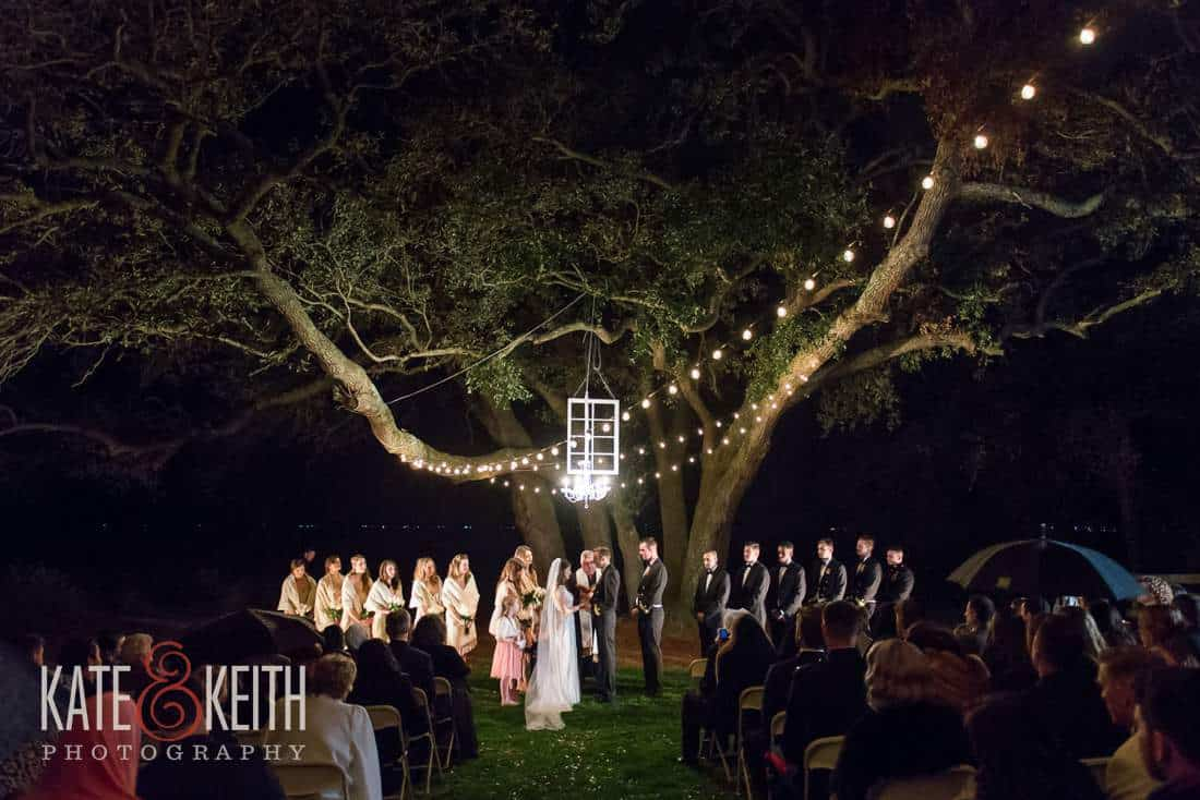 outdoor wedding under tree with chandelier