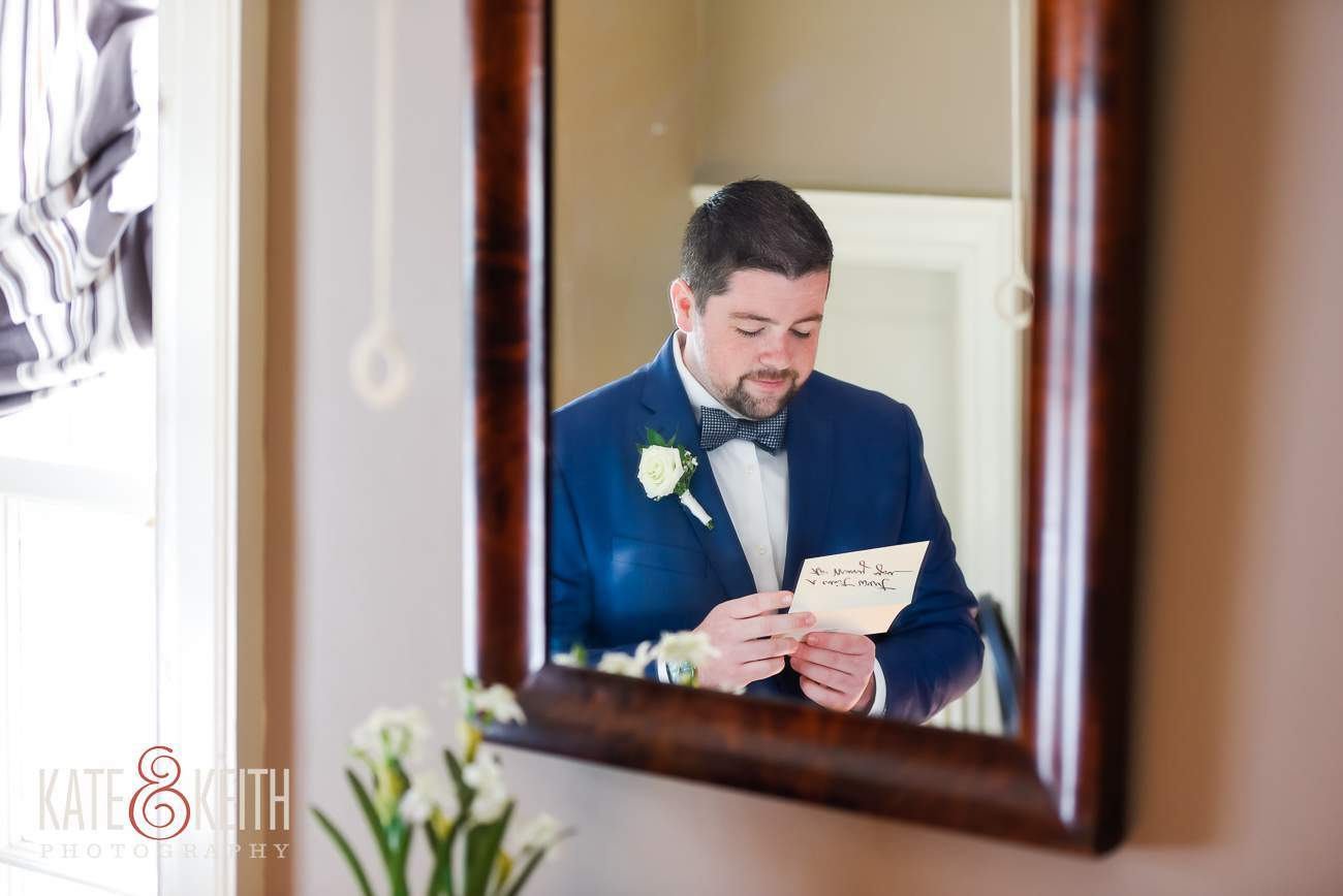 Groom Reads Bride's Letter Wedding Photojournalism
