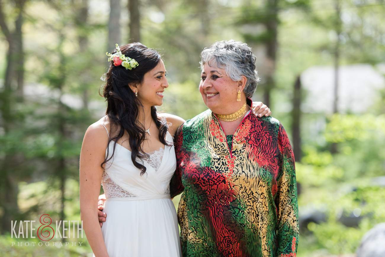 Natural candid wedding photo bride and mother moment