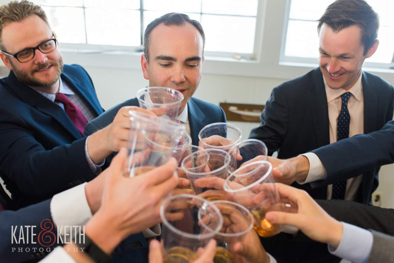 Groomsmen celebrate with scotch