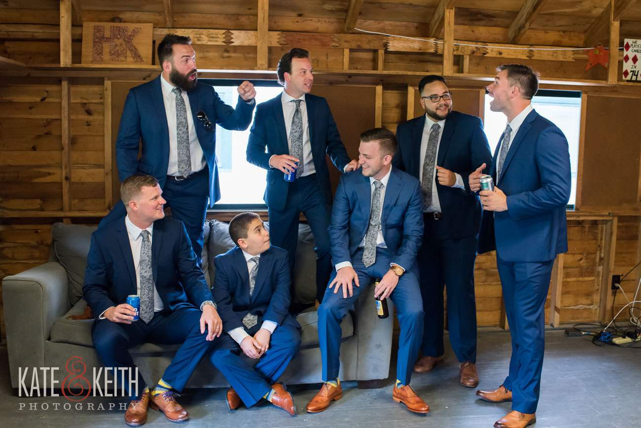 Casual unposed wedding portrait of groomsmen