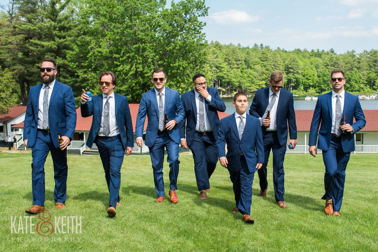 Casual unposed wedding portrait of groomsmen at Camp Mataponi
