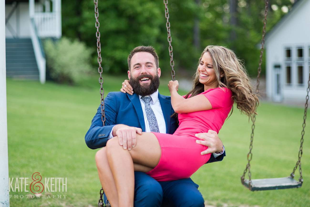 Cute couple on a swing laughing