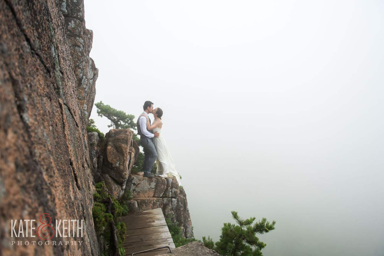 Bride and Groom on cliff in Acadia National Park
