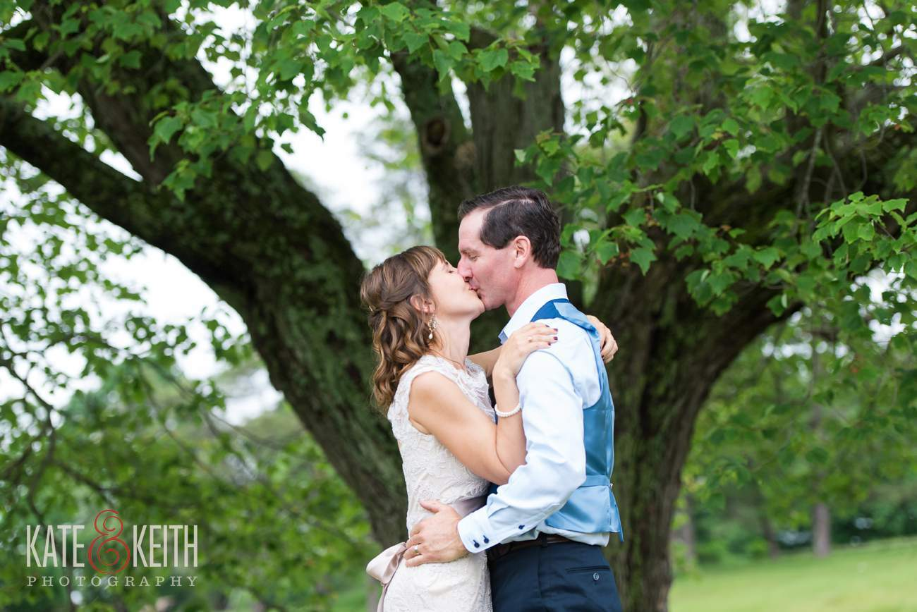 Farm wedding first kiss