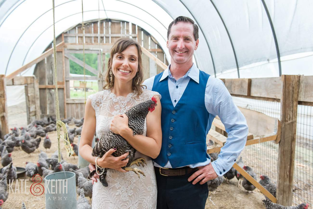 Bride and groom with chicken livestock