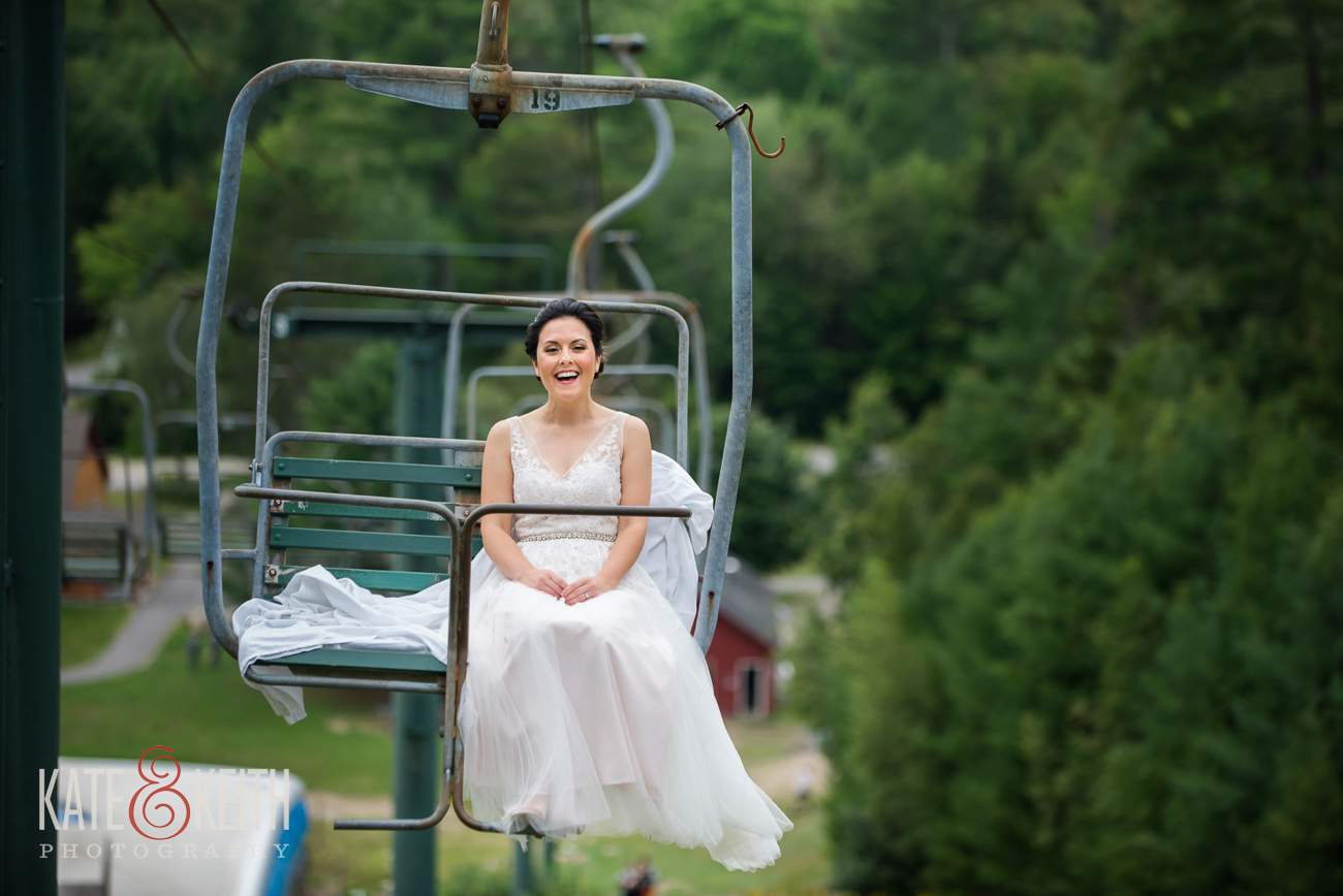 Bride on chairlift at Waterville Valley Resort wedding