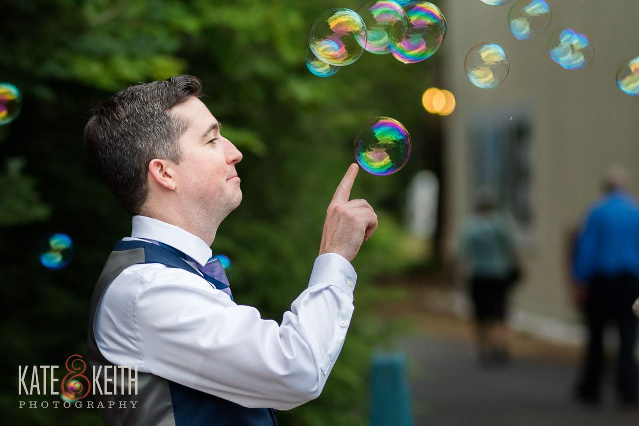 Groom pops bubbles at wedding reception Waterville Valley Resort