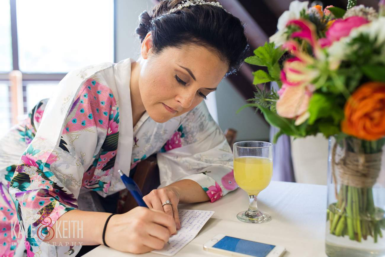 Bride writing note to groom