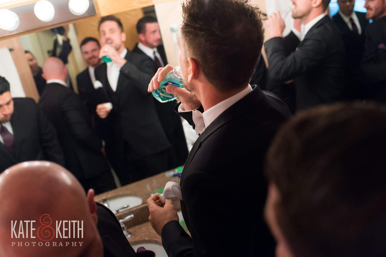 Groom in bathroom Story telling wedding photography