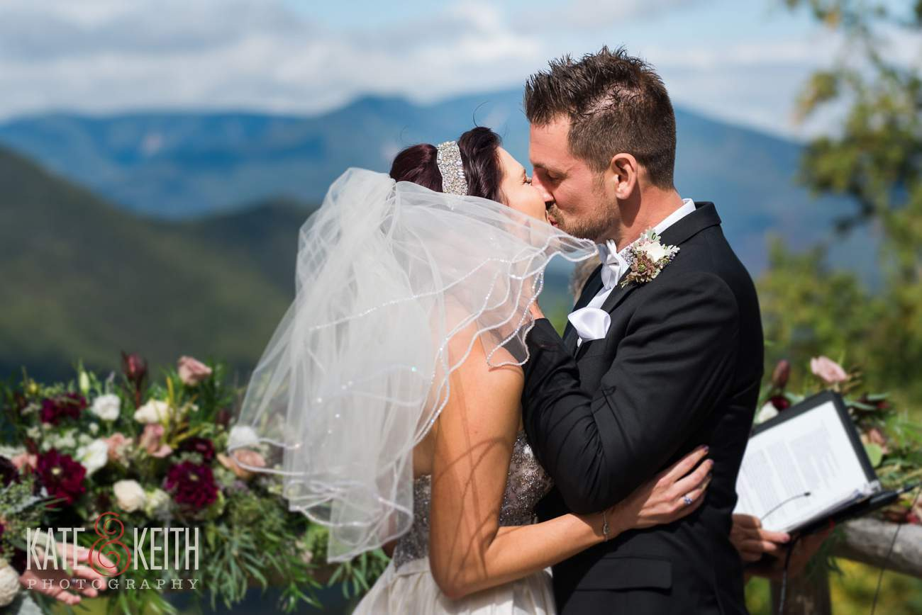 Loon Mountain wedding ceremony windy first kiss