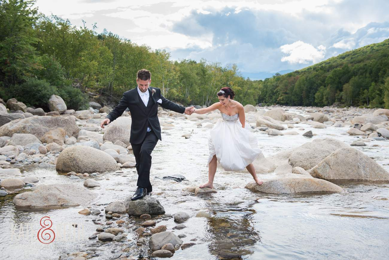 Rock hopping bride and groom