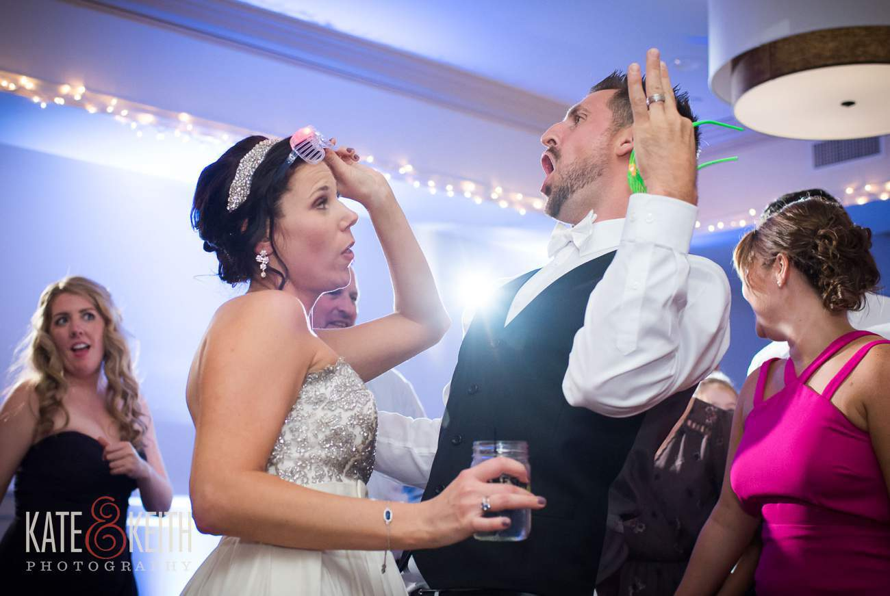Bride and groom having an amazing time dancing