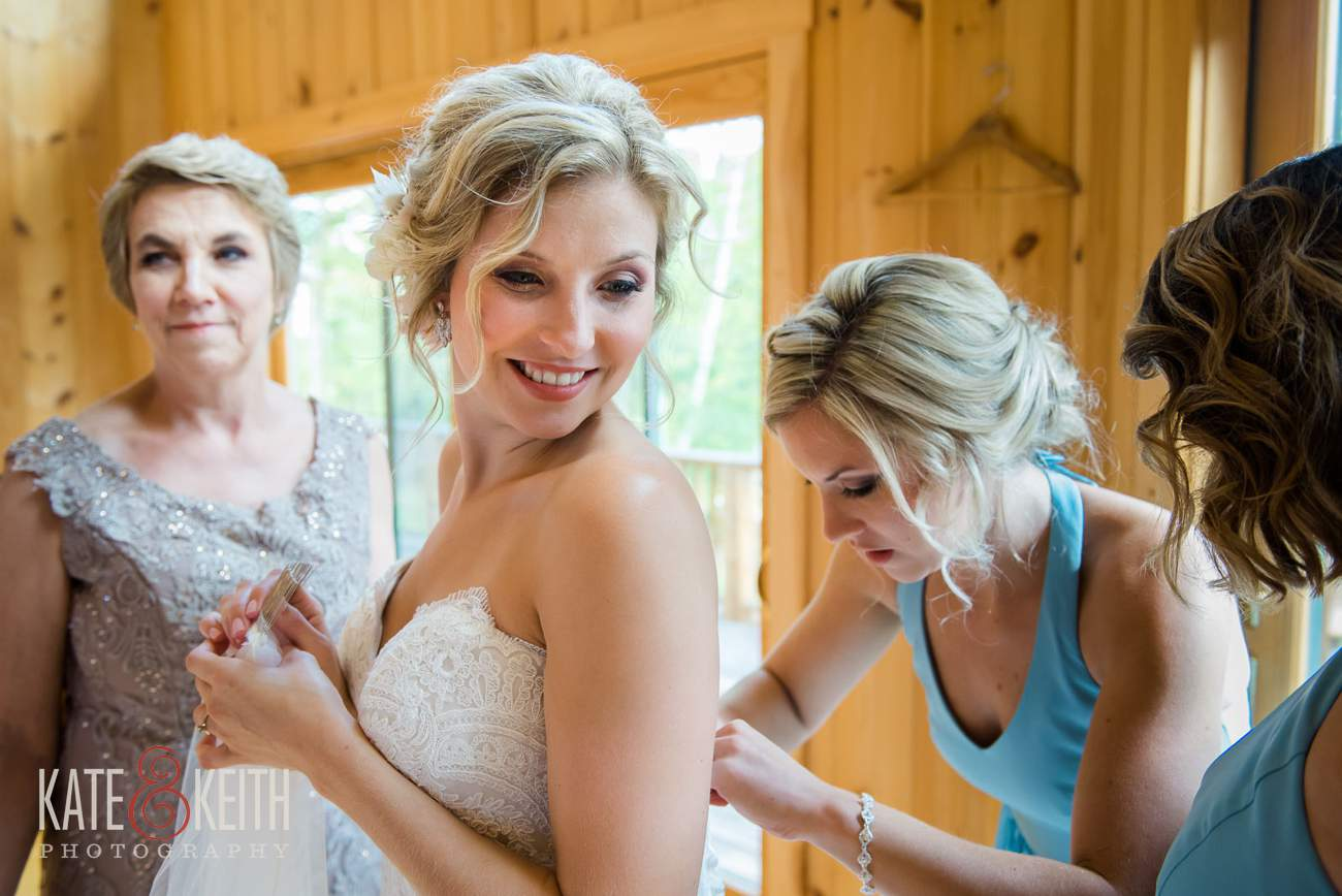 Bridesmaids help bride prep Lake Shore Village Resort