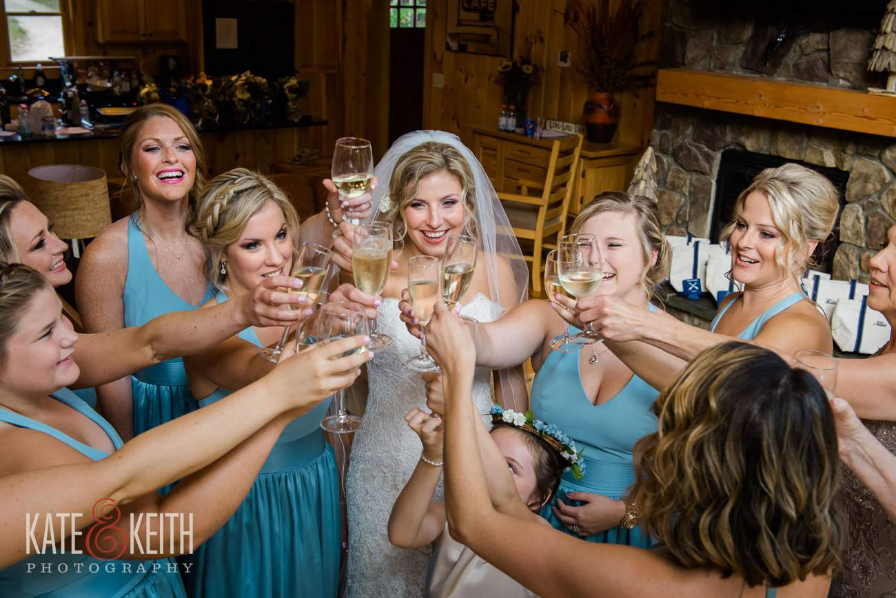 Bridal party toast Lake Shore Village resort wedding
