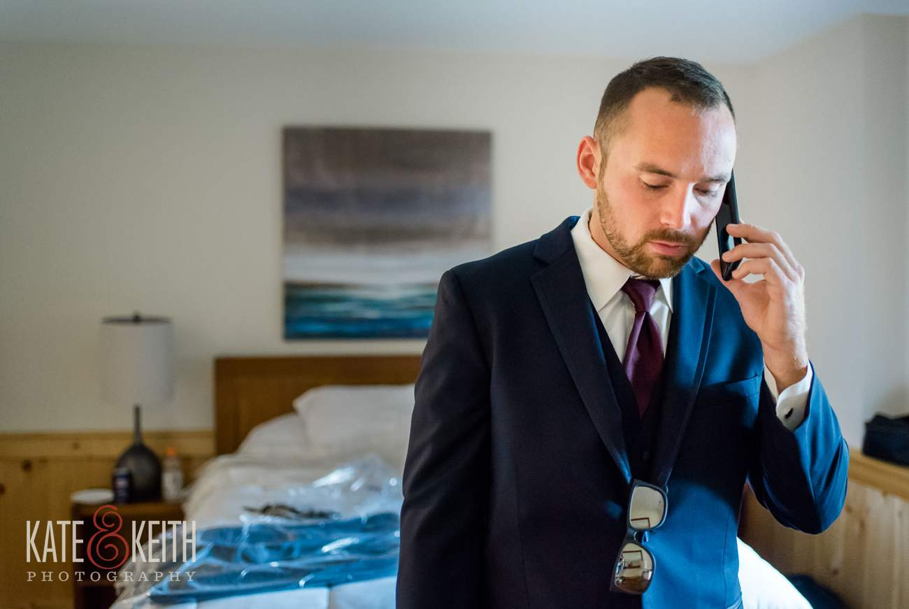 Formal groom on telephone
