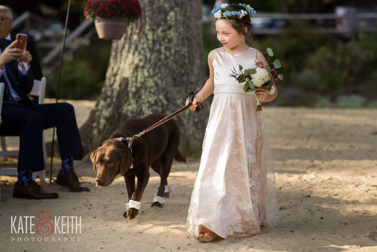 Flower girl and dog wedding aisle