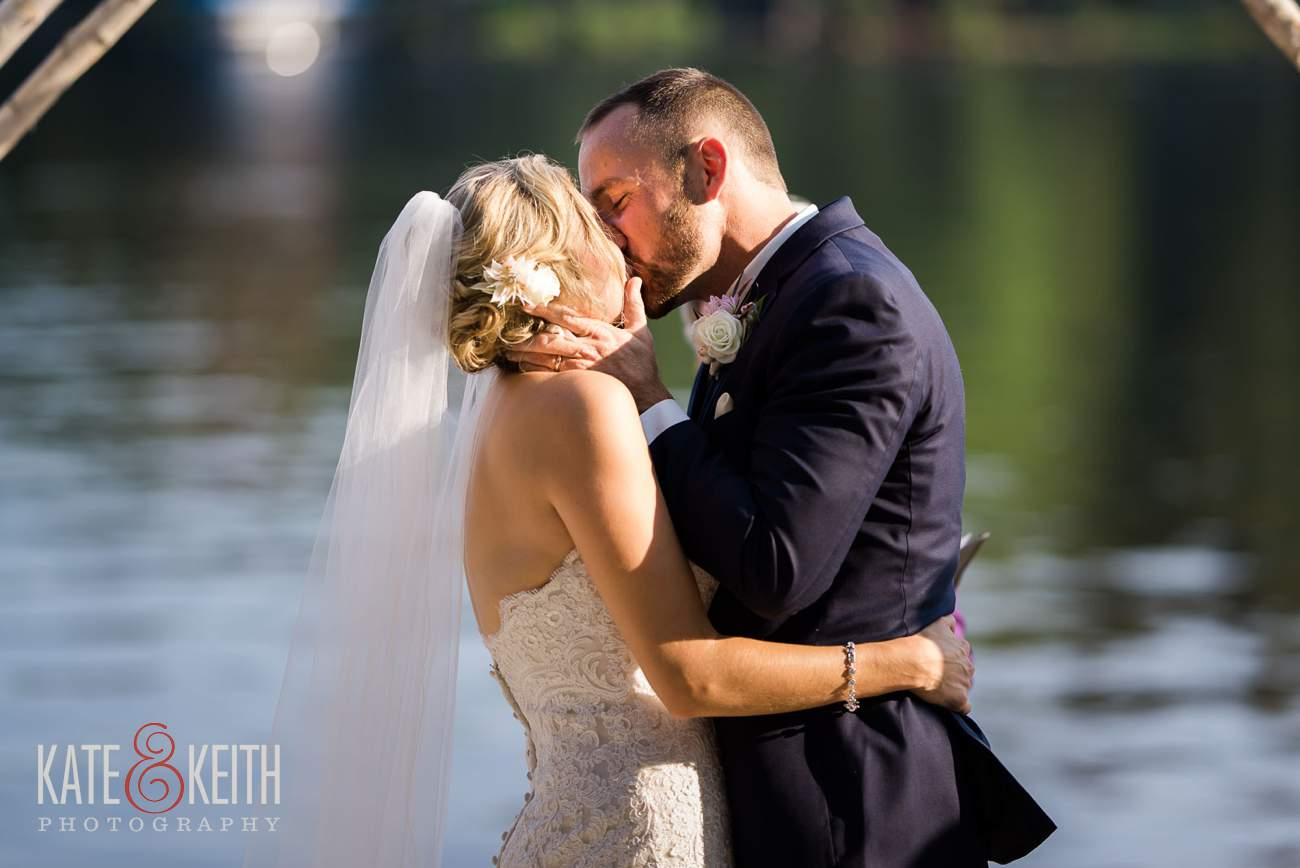 First kiss Lake Shore Village Resort Wedding
