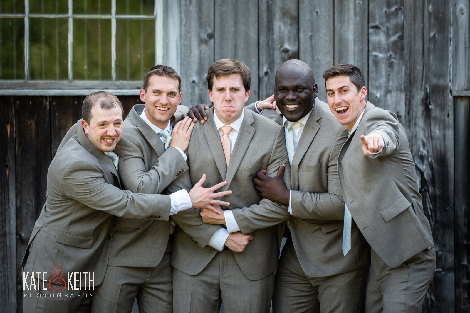 fun portrait with groom and groomsmen, silly wedding party photos