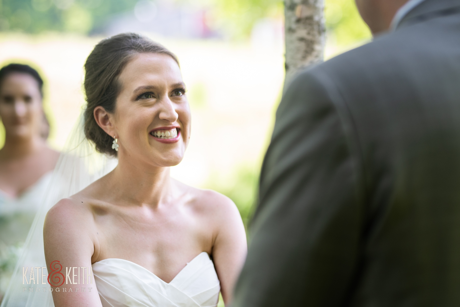 happy smiling laughing bride during June outdoor wedding ceremony