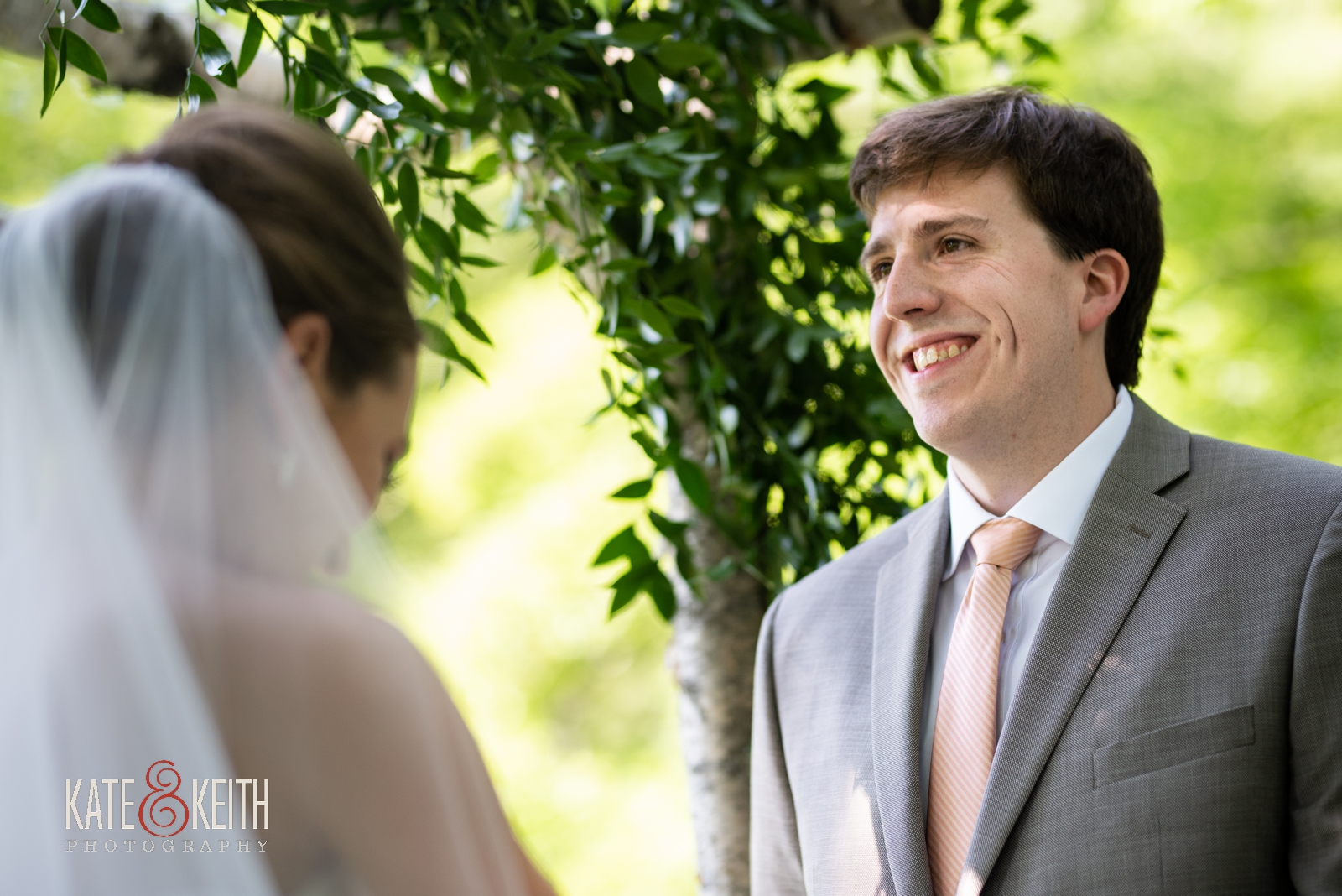 happy smiling laughing groom June outdoor ceremony Vermont Grafton Inn