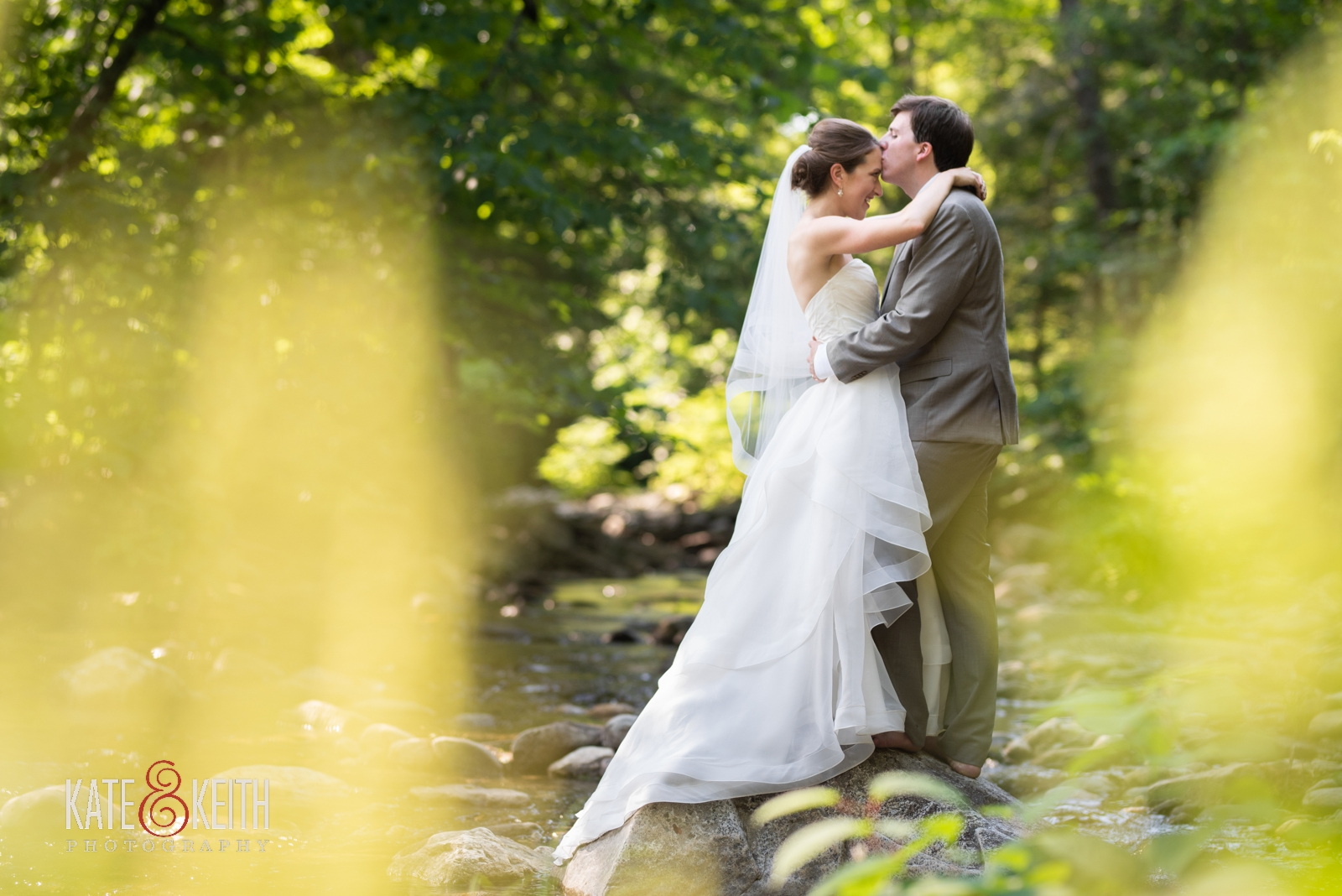 bride and groom outdoor wedding photos in stream Grafton Vermont