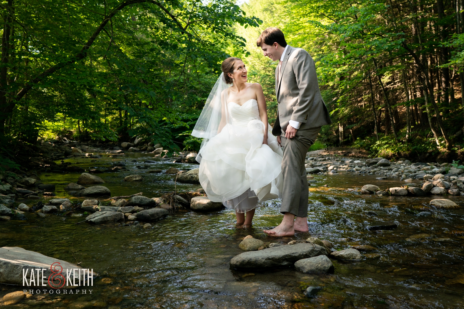 bride and groom fun barefoot wedding photos in stream Vermont