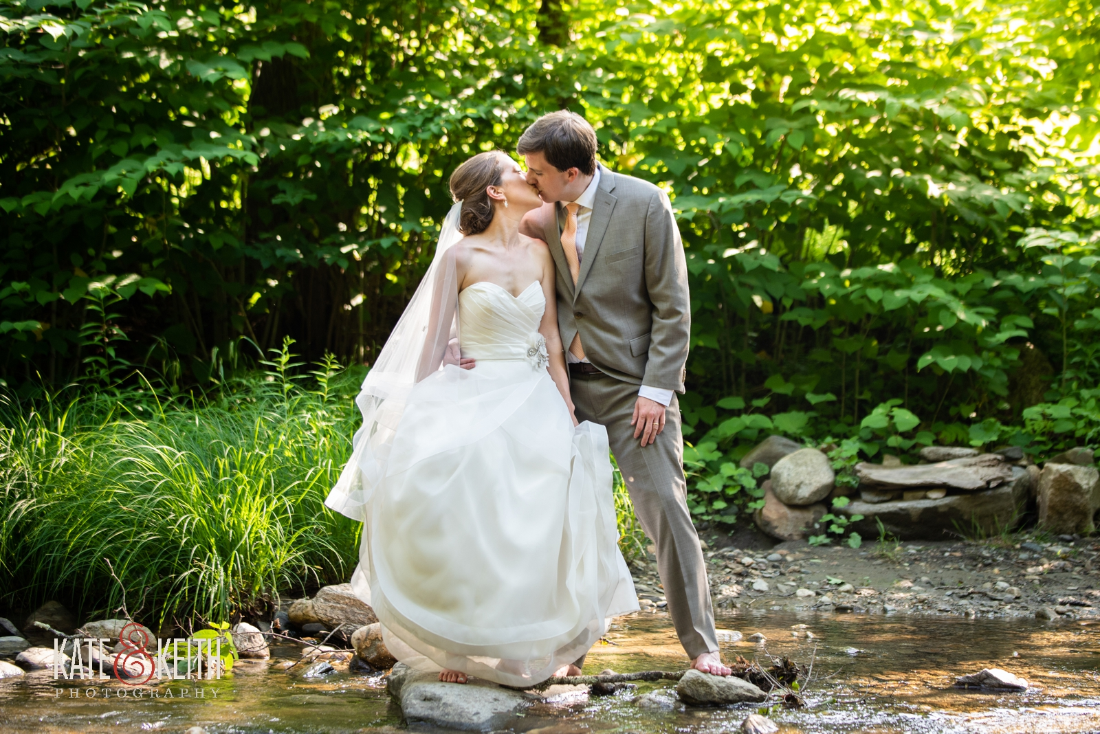 informal barefoot outdoor wedding photos of bride and groom