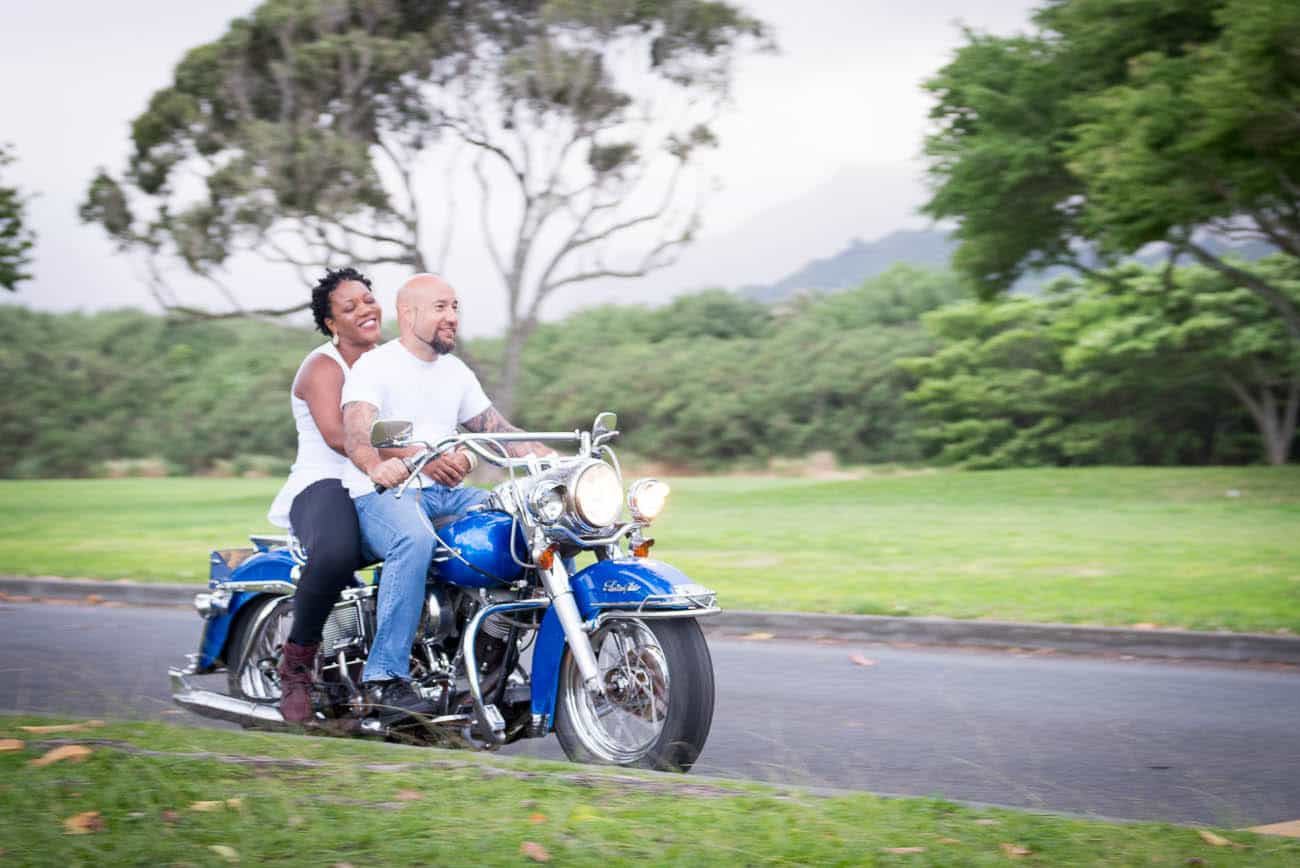couple Riding motorcycle engagement photos