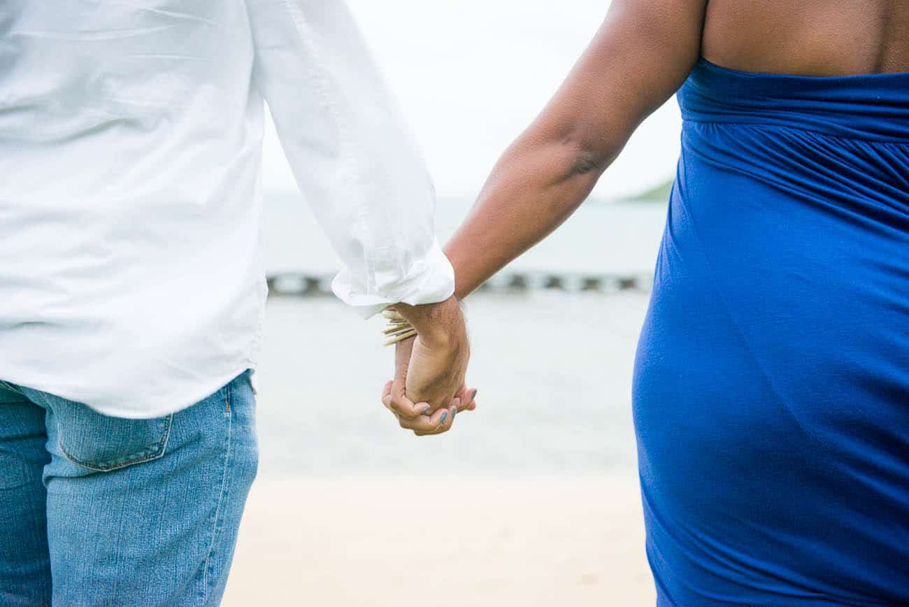 interracial couple holding hands engagement photos