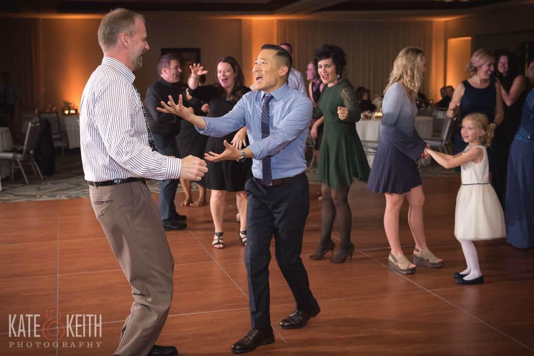two guys wedding dancing