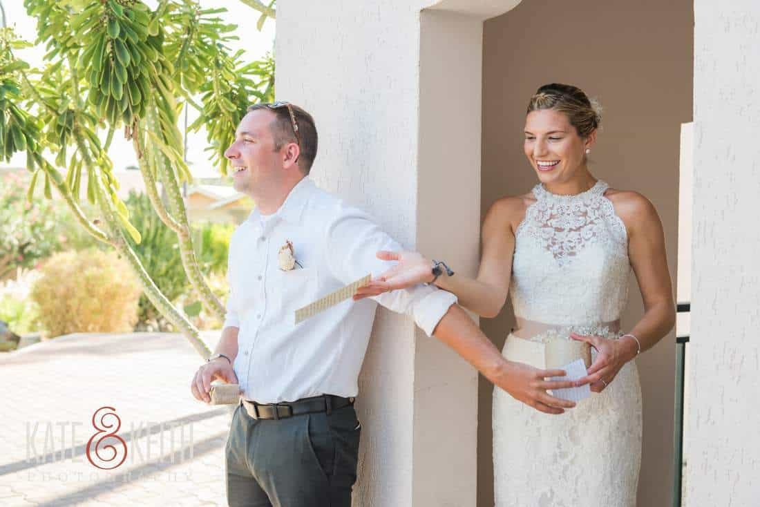 Bride and groom exchange gifts